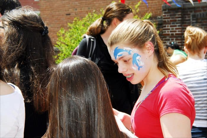 Skye Sunderhauf, 11, shows off her newly painted face to her friend at the Embassy of Costa Rica, during Passport DC festivities Saturday, May 2.