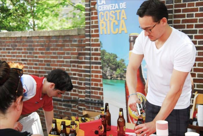 Erick Marín opens bottles of Imperial beer for visitors to the Embassy of Costa Rica.