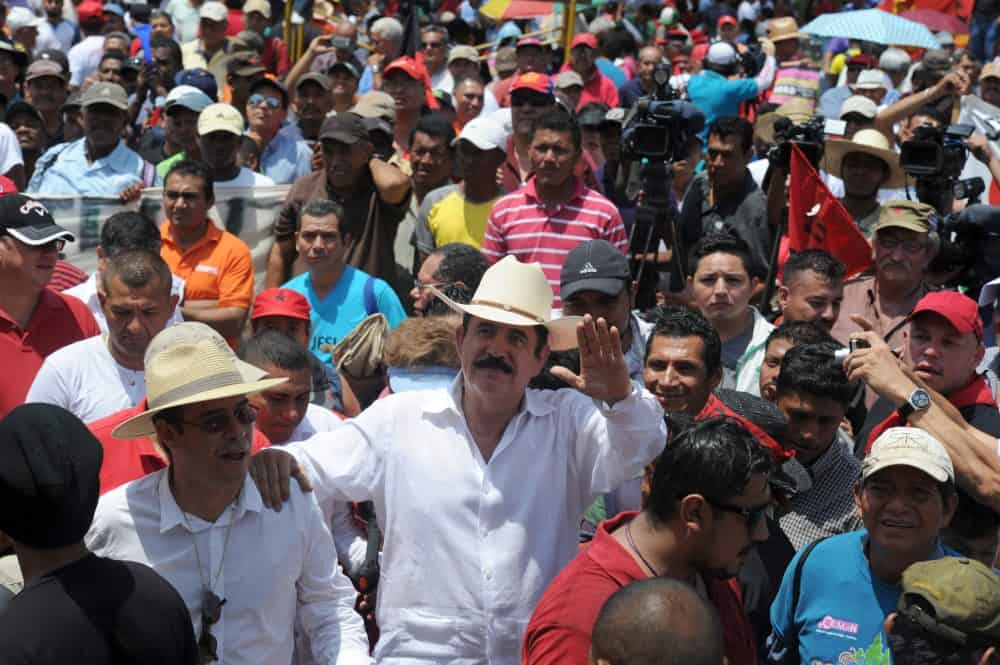 Former Honduran President Manuel Zelaya (center) participates in the May Day march in Tegucigalpa on May 1, 2015.