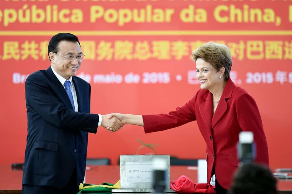 China's Prime Minister Li Keqiang, left, and Brazilian President Dilma Rousseff shake hands.