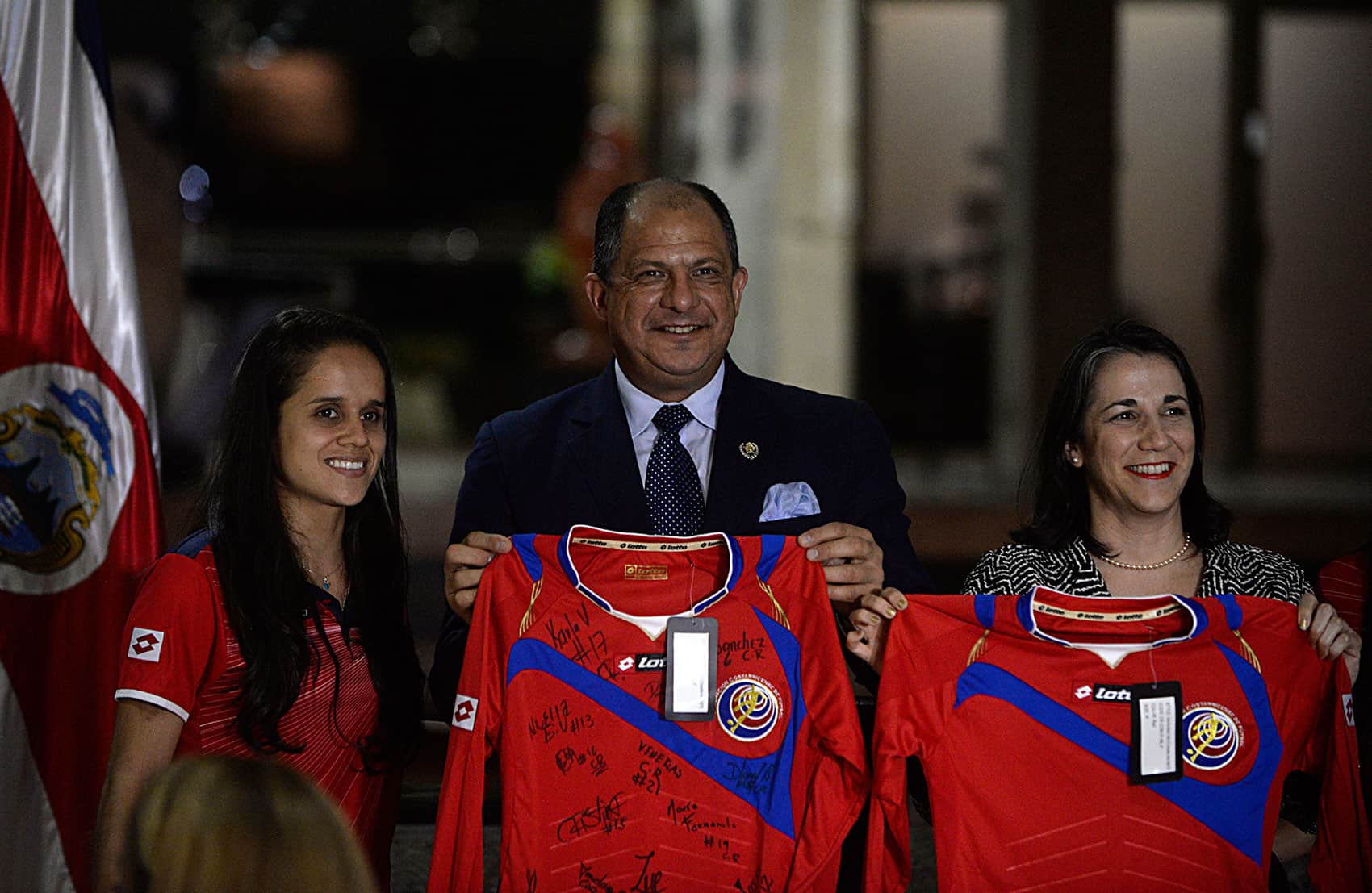 Las Ticas captain Katherine Alvarado stands with President Luis Guillermo Solís and First Lady Mercedes Peñas at a dinner honoring the Costa Rican Women's World Cup team on May 11, 2015.