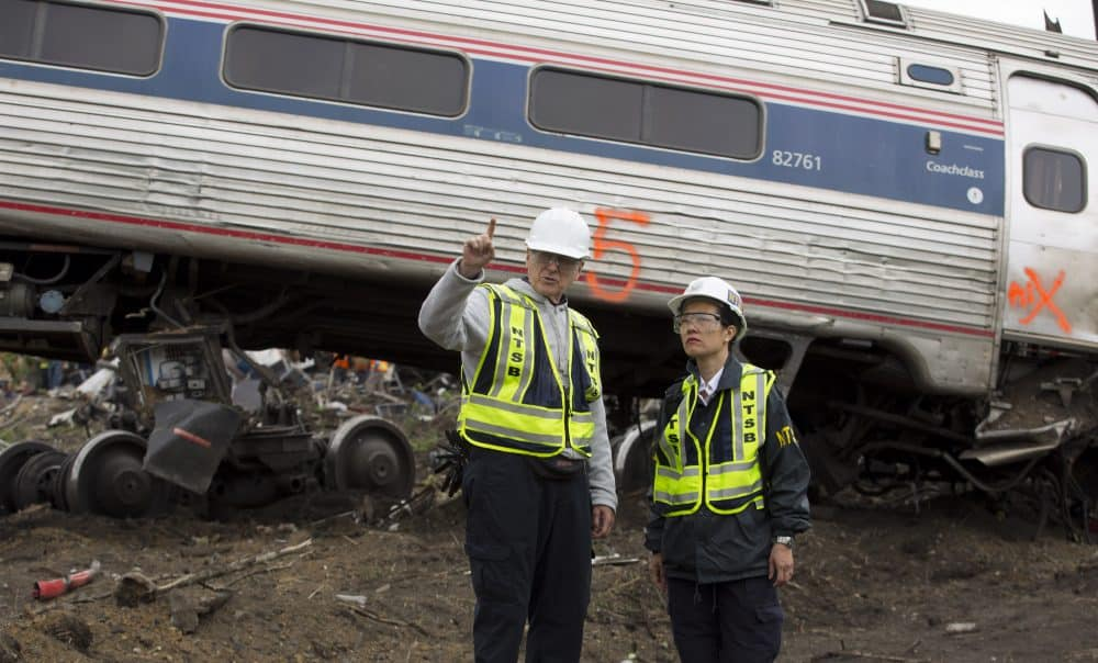 NTSB Rail Safety Investigator Mike Flanigon (left) briefs Vice Chairman Dinh-Zarr at the scene of an Amtrack train that derailed in Philadelphia, Penn., May 13, 2015.