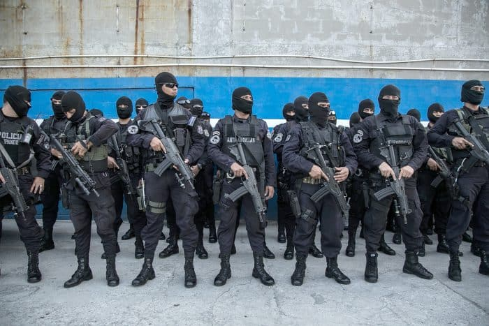 Anti-gang police officers receive instructions for an operation in a dangerous neighborhood in San Salvador.