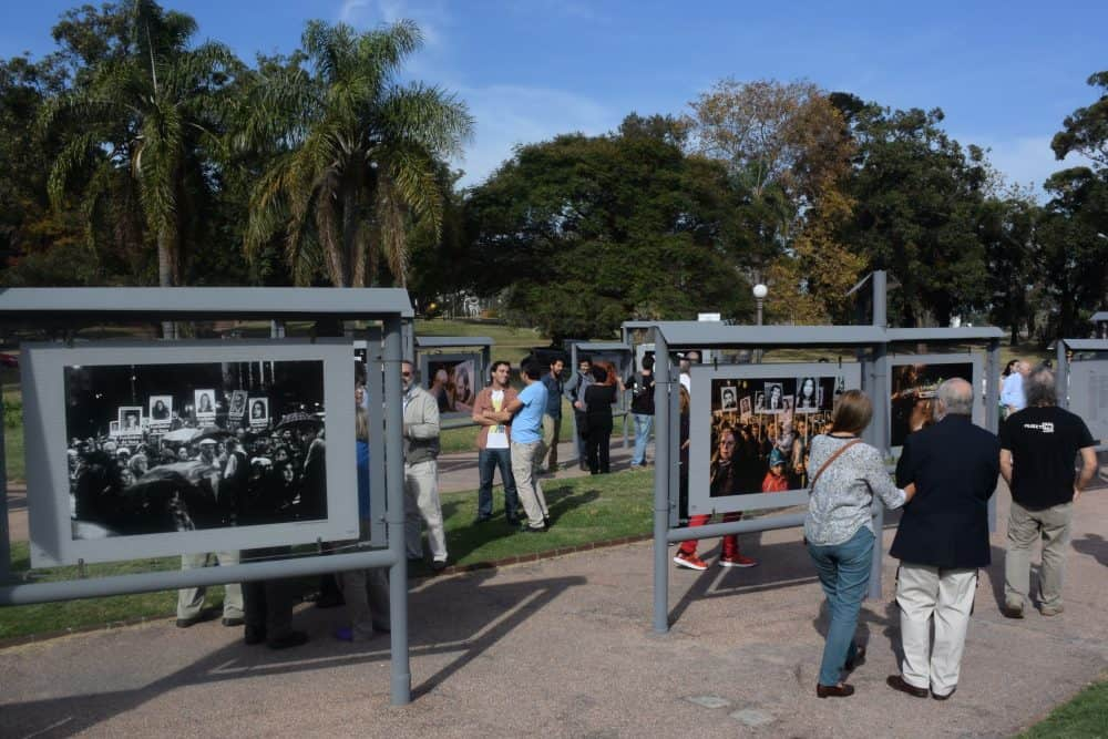"""People visit the """"Images of Silence, 20 Years of Marches"""" photo exhibition, on display in Montevideo on May 19, 2015 in the framework of the 20th March of Silence to demand of justice for the Uruguayans who disappeared during the dictatorships in the Southern Cone."""