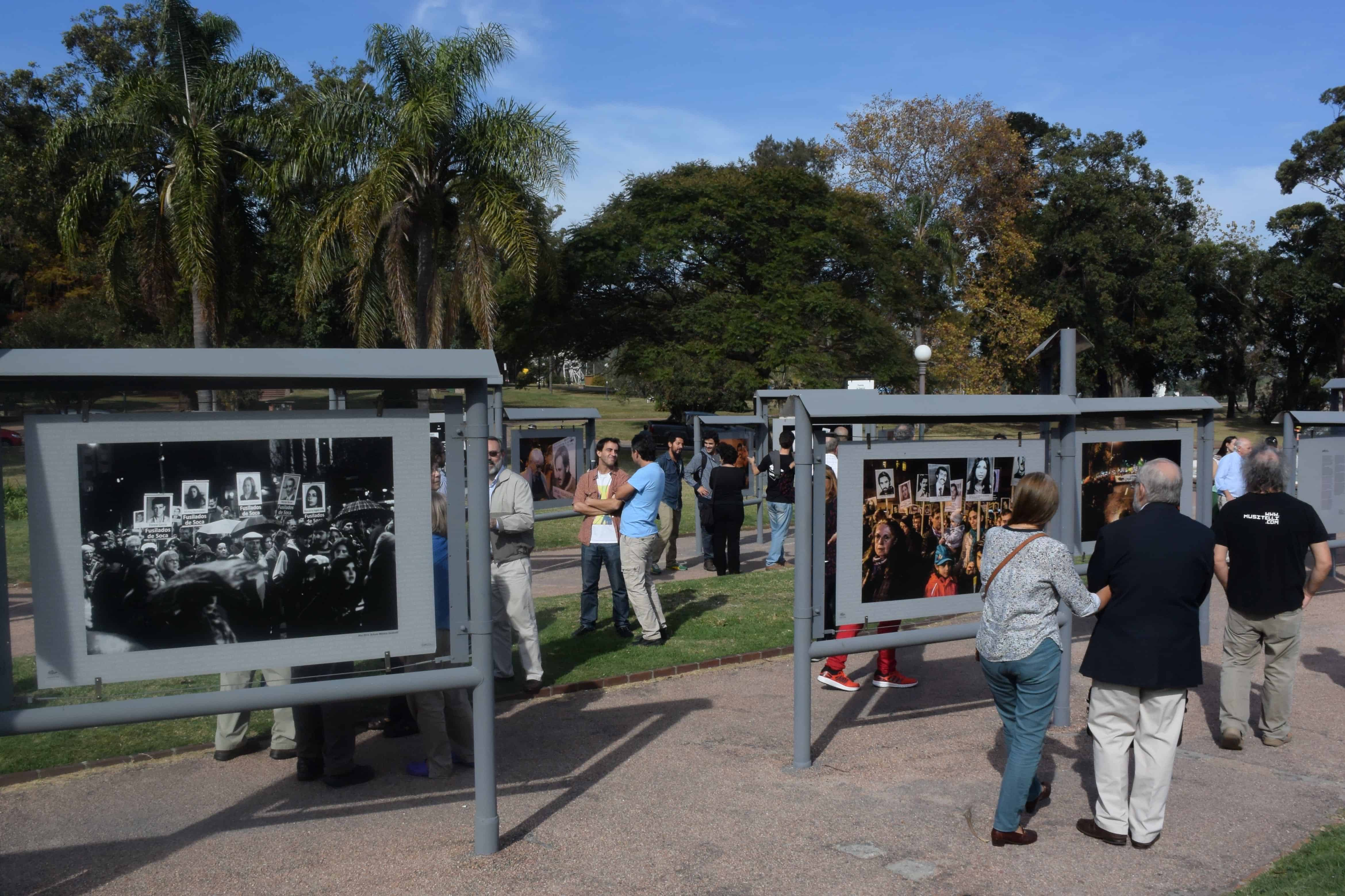 "People visit the ""Images of Silence, 20 Years of Marches"" photo exhibition, on display in Montevideo on May 19, 2015 in the framework of the 20th March of Silence to demand of justice for the Uruguayans who disappeared during the dictatorships in the Southern Cone."
