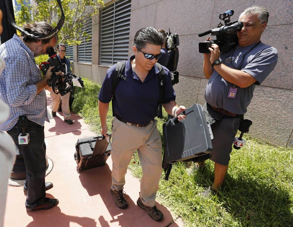 FBI agents exit the headquarters of CONCACAF.