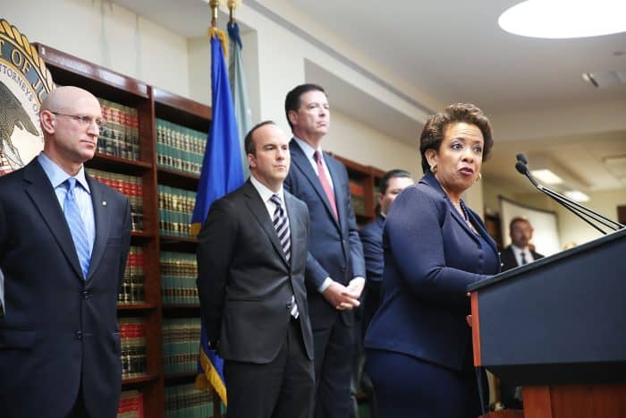 Attorney General Loretta Lynch speaks at a packed news conference.