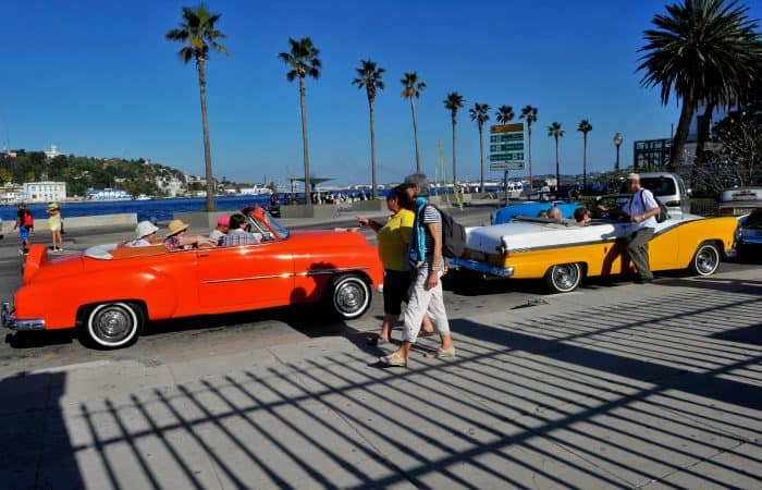 Tourists from the United States are seen in old American cars in Havana.