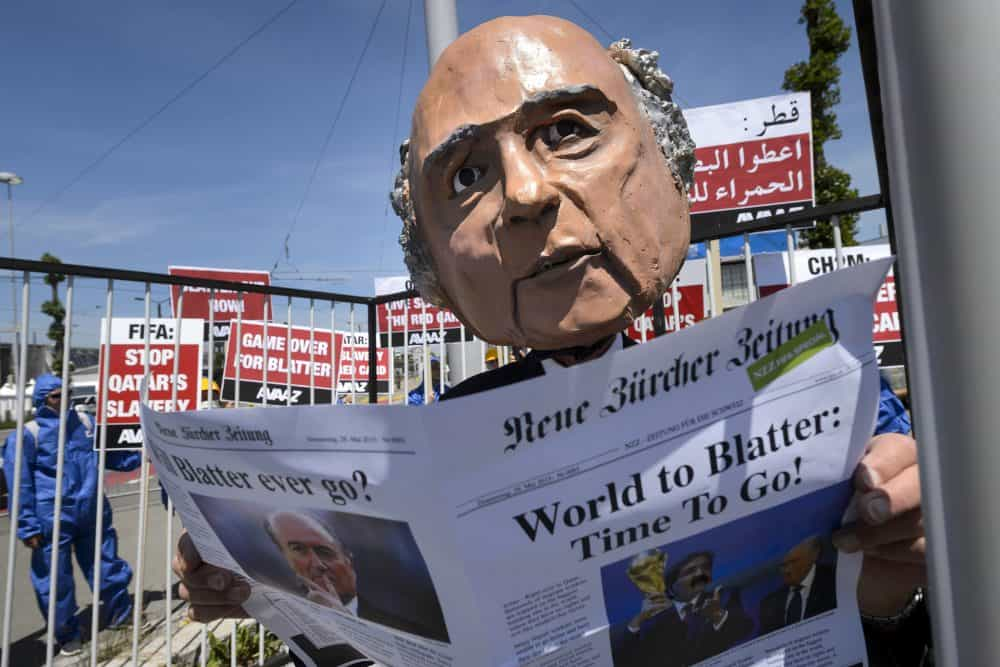 A demonstrator disguised as FIFA President Sepp Blatter takes part in a protest against the condition of workers in Qatar.