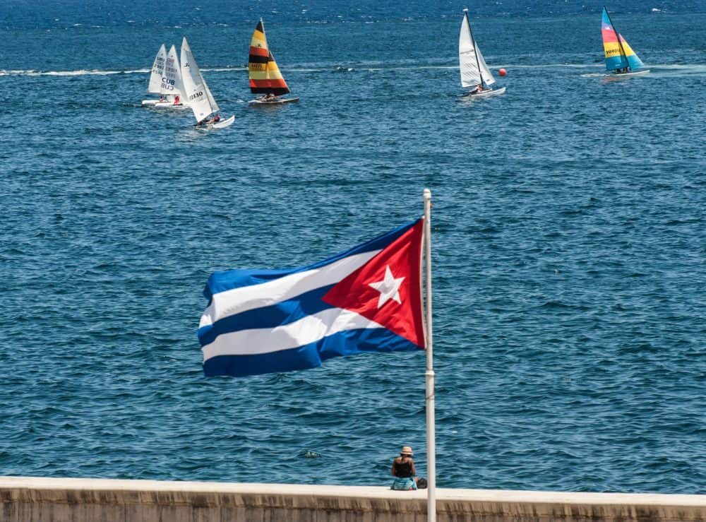 A Cuban national flag flutters as participants of the Havana Challenge regatta compete in Havana.
