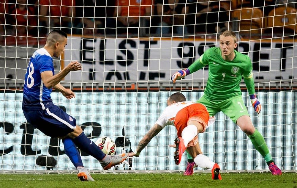 U.S. player Bobby Wood, left, scores a goal past the Netherlands' goalkeeper Jasper Cillessen.