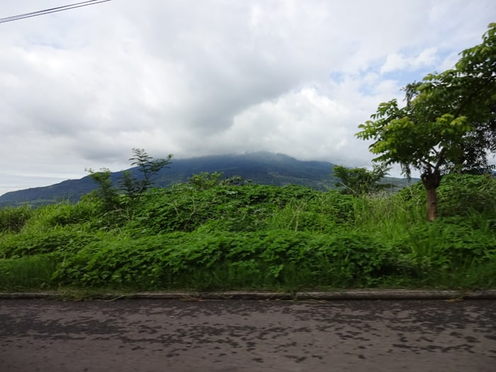 A mountain — volcano? — shrouded by clouds in El Salvador.