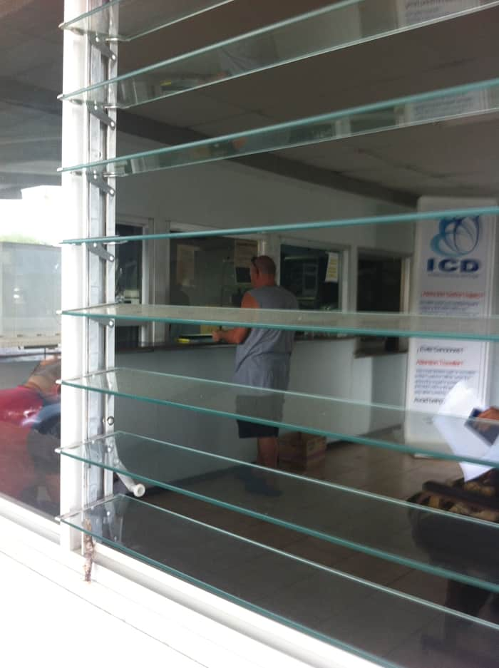 Paul waits at the window where you register cars.