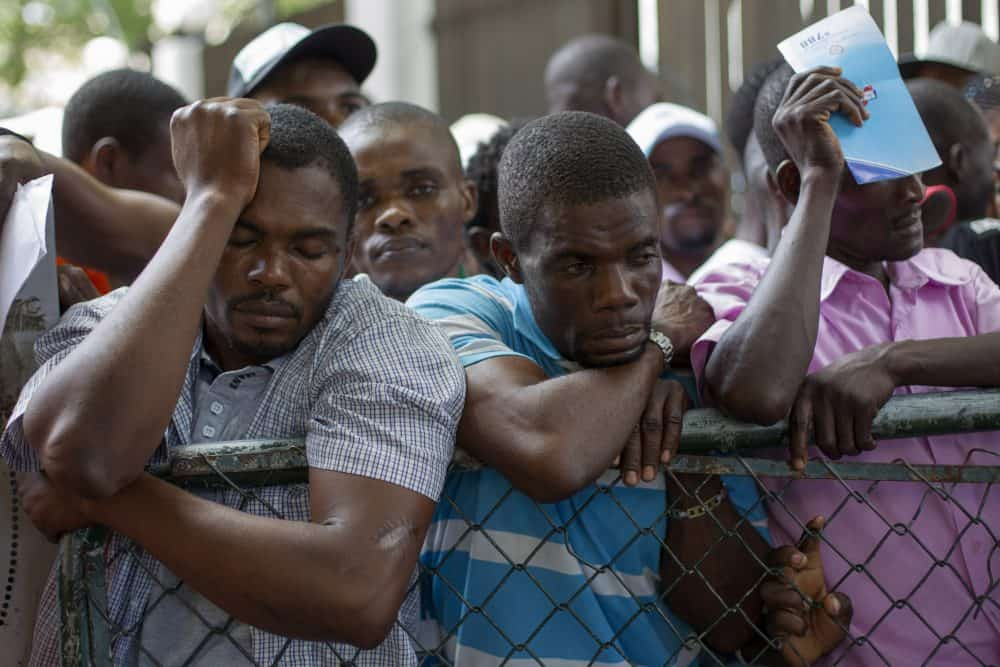 Haitians queue up to legalize their status at the Interior Ministry in Santo Domingo, Dominican Republic.