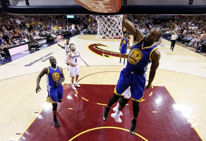 Andre Iguodala (#9) of the Golden State Warriors dunks against the Cleveland Cavaliers.