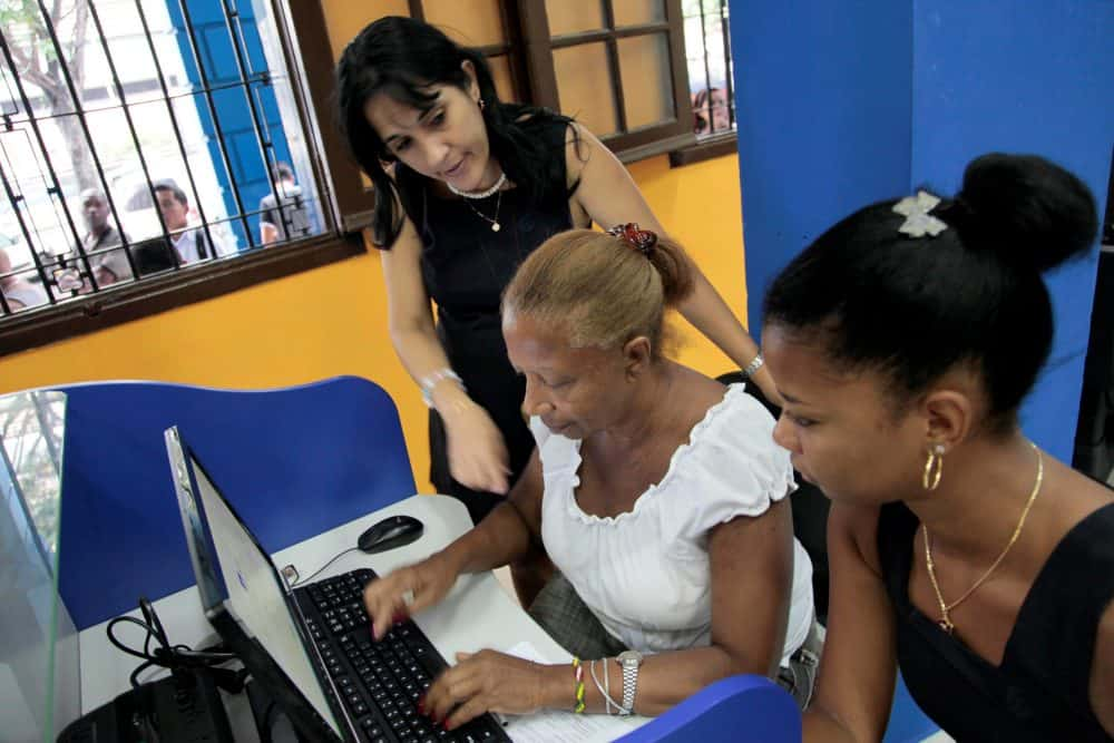 An employee of Cuban telecommunications company ETECSA helps a client.