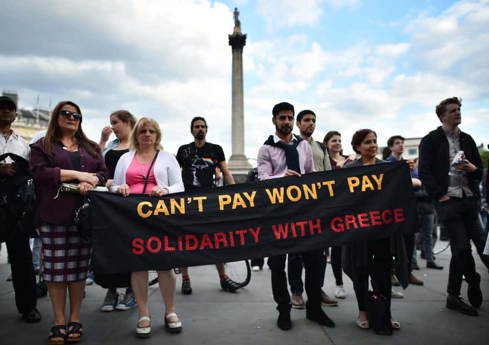 Demonstrators gather to show solidarity towards the people of Greece.