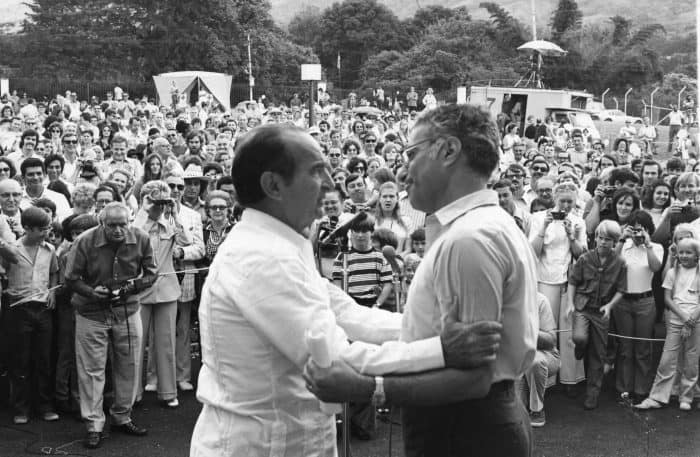 "Costa Rican President José ""Pepe"" Figueres embraces U.S. Ambassador Viron Vlaky at the 1973 picnic."