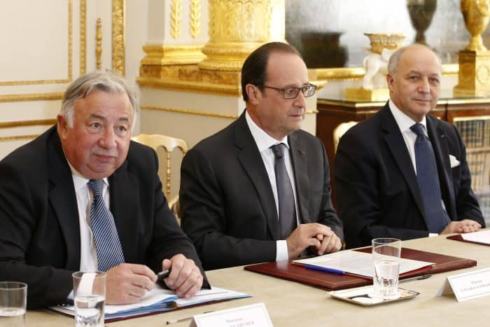 French Senate President Gerard Larcher, left, French President Francois Hollande, center, and French Foreign Minister Laurent Fabius.