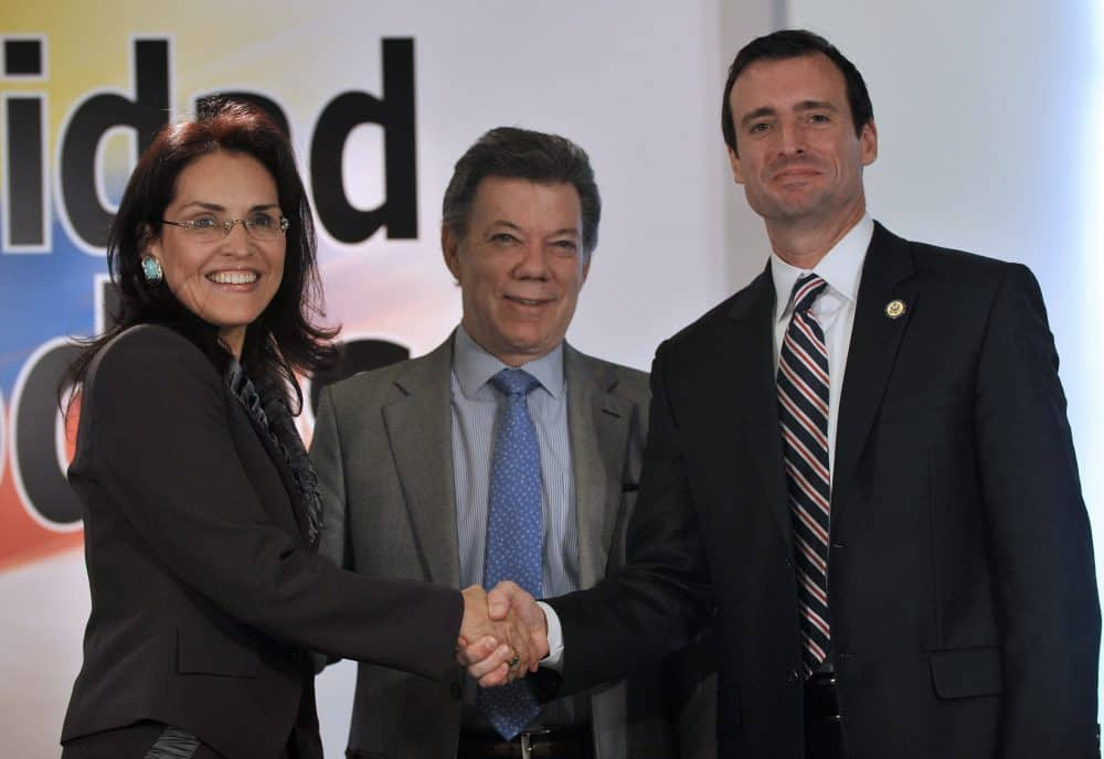 In this 2011 file photo, Colombia's President Juan Manuel Santos, center, shakes hands with Colombia's Attorney General Viviane Morales and U.S. Attorney for the Southern District of Florida Wifredo Ferrer.