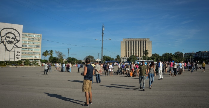 Journalists and dissidents wait for Cuban performance artist Tania Bruguera at Revolution Square in Havana, on Dec. 30, 2014.