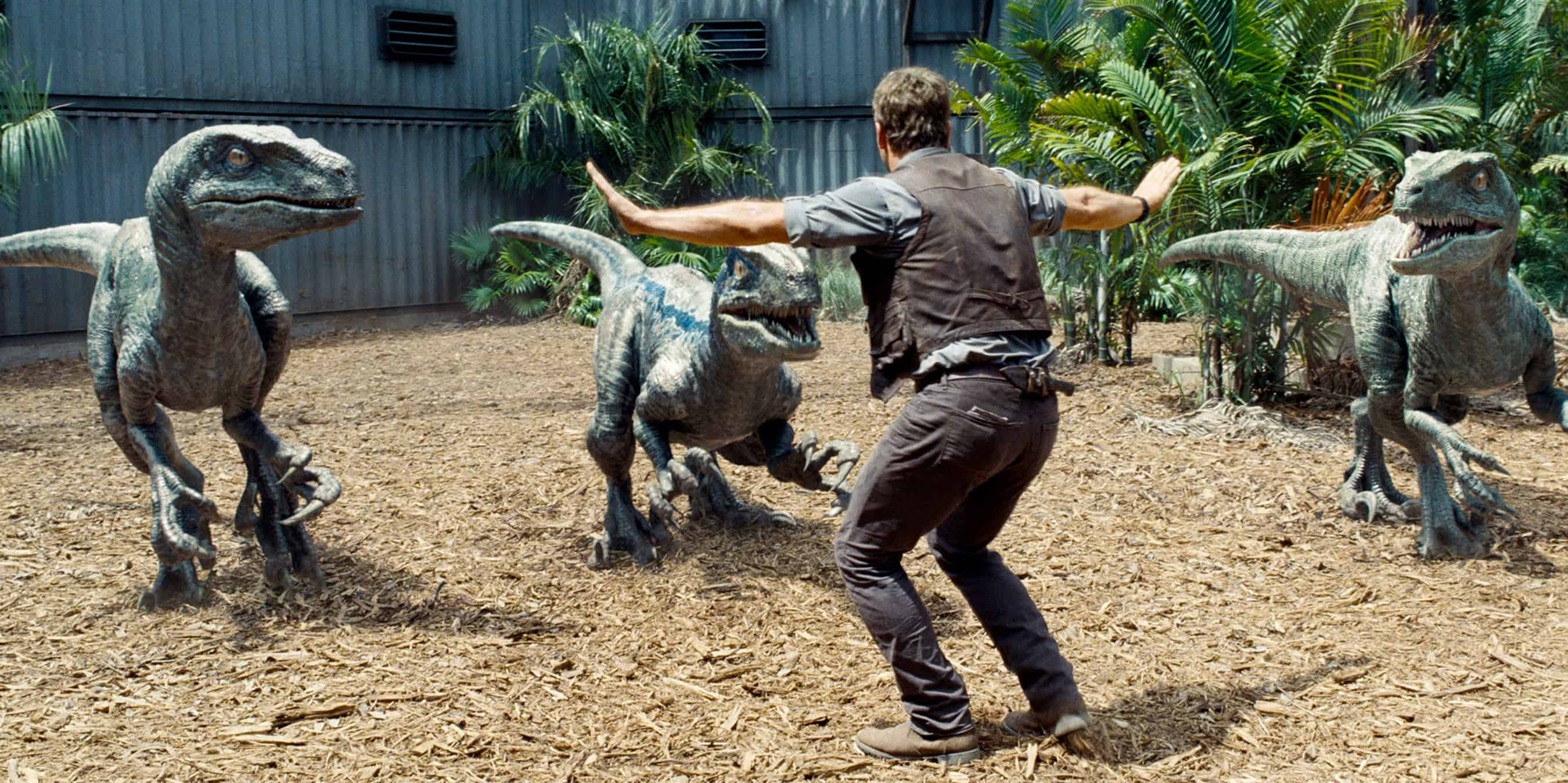 "Actor Chris Pratt is surrounded by raptors in """"Jurassic World""."""