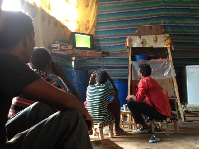 a group of Ethiopians in the Danakil area near the Eritrean border watch Costa Rica vs. Spain on June 11.