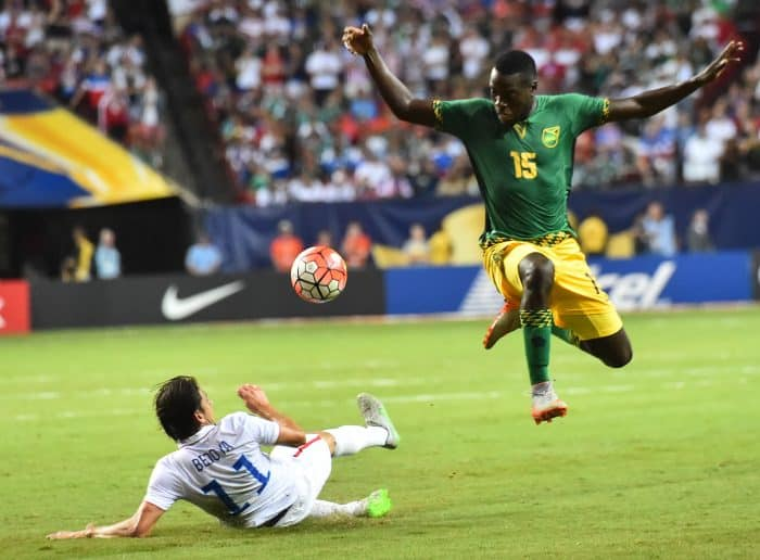 Jamaica's Je-Vaughn Watson (R) vies with Alejandro Bedoya of the U.S. during a CONCACAF Gold Cup semifinal football match.