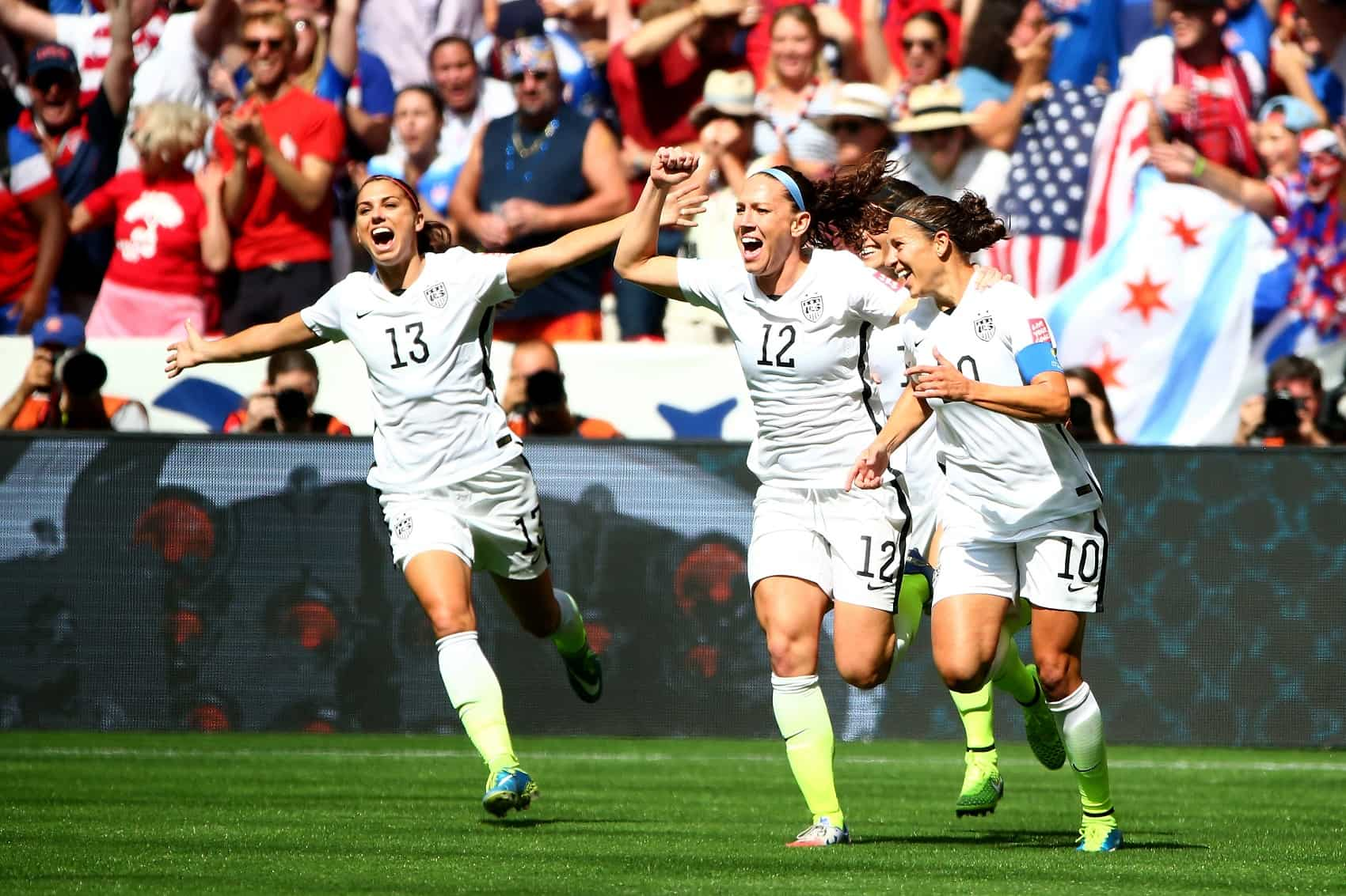 Lauren Holiday #12 and Carli Lloyd #10 of the United States celebrate with teammates after Lloyd scores her second goal against Japan in the FIFA Women's World Cup Canada 2015 Final at BC Place Stadium on July 5, 2015 in Vancouver, Canada.