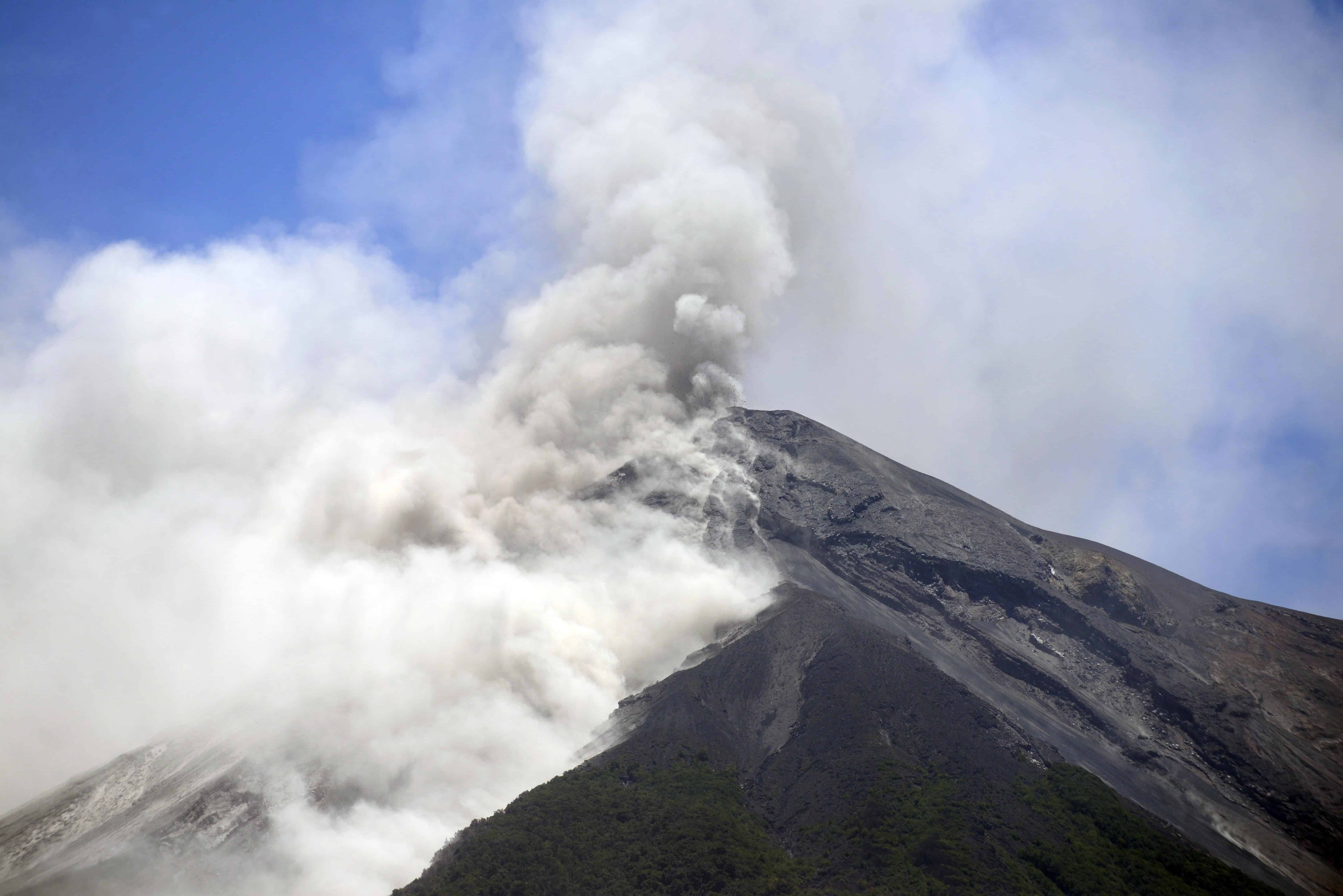 The Fuego Volcano, seen from Alotenango municipality, Sacatepequez departament, about 65 km southwest of Guatemala City, erupts on July 1, 2015. The volcano spewed lava and columns of ash into the air and authorities have raised the alert level in the area to orange.