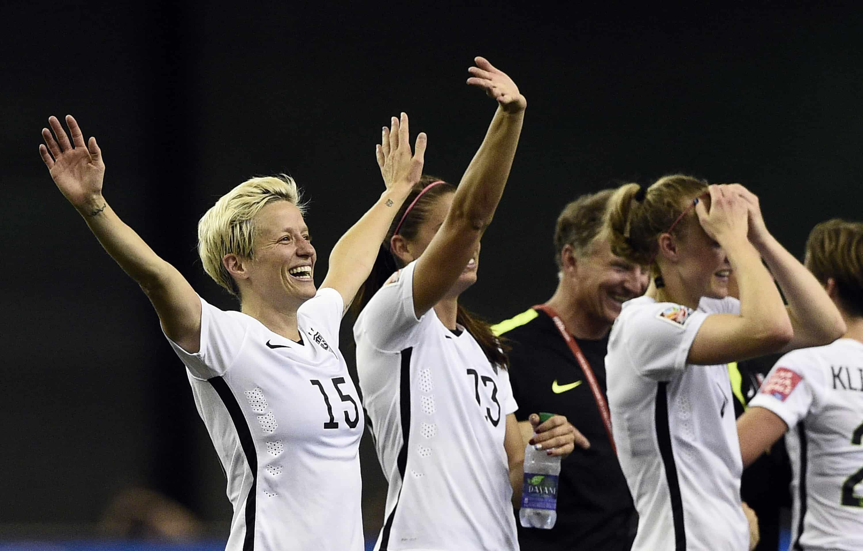 U.S. midfielder Megan Rapinoe celebrates after winning the semi-final .