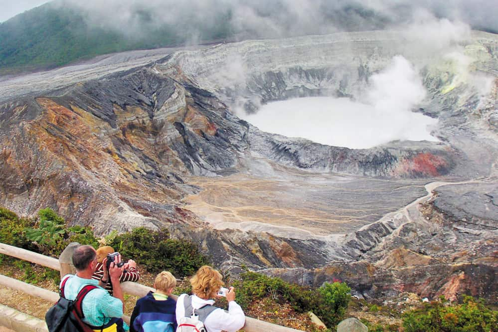 Visitors to Poás Volcano National Park's crater overlook.