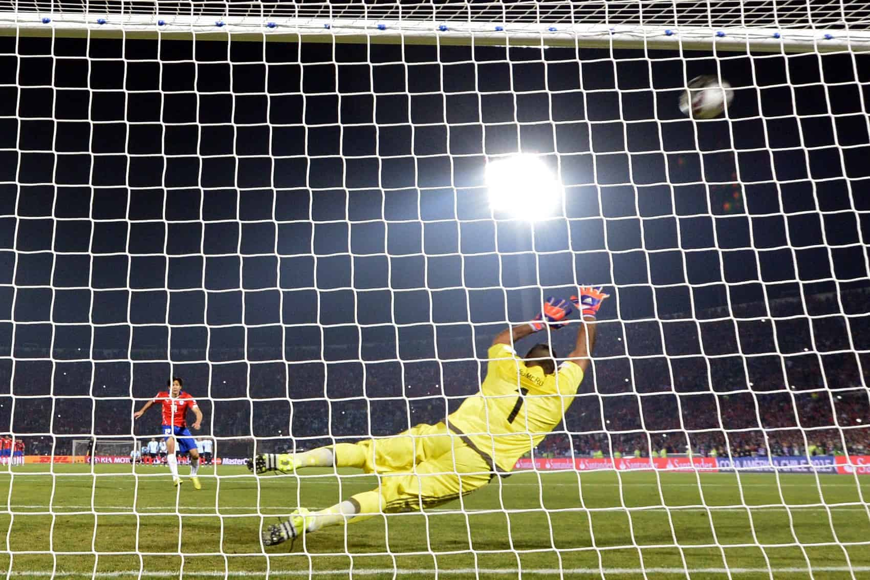 Chile's midfielder Matias Fernandez scores against Argentina during the penalty shootout of the 2015 Copa America football championship.