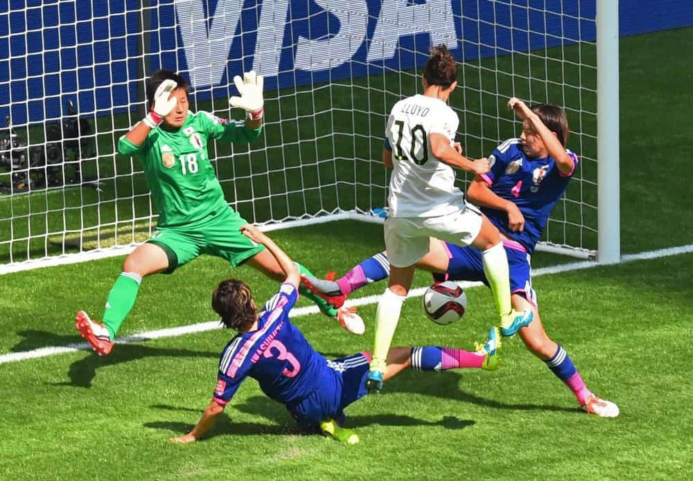 The US's Carli Lloyd (2R) scores a goal against Japan during the 2015 FIFA Women's World Cup final between the USA and Japan at BC Place Stadium in Vancouver, British Columbia on July 5, 2015.