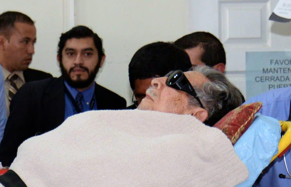 Former Guatemalan de facto president (1982-1983), retired General José Efraín Ríos Montt, arrives on a stretcher as a retrial against him opens in Guatemala City, on January 5, 2015.