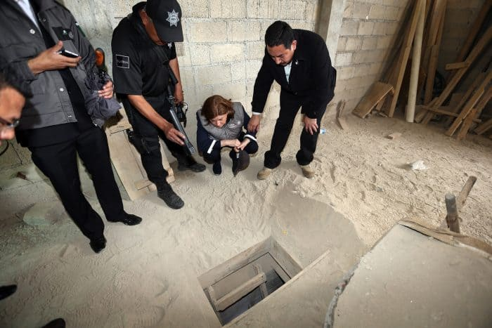 "Mexico's Attorney General, Arely Gómez (second from right), looks at the alleged end of the tunnel through which Mexican drug lord Joaquín ""El Chapo"" Guzmán could have escaped from the Altiplano prison, at a house in Almoloya de Juárez, Mexico, on July 12, 2015."
