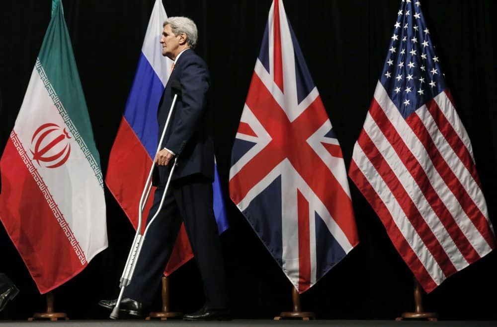 "U.S. Secretary of State John Kerry leaves the stage after a group picture with foreign ministers and representatives from China, Iran, Britain, Germany, France, and the European Union at the Vienna International Center in Vienna, Austria July 14, 2015. Iran and six major world powers reached a nuclear deal on Tuesday, capping more than a decade of on-off negotiations with an agreement that could potentially transform the Middle East, and which Israel called an ""historic surrender""."