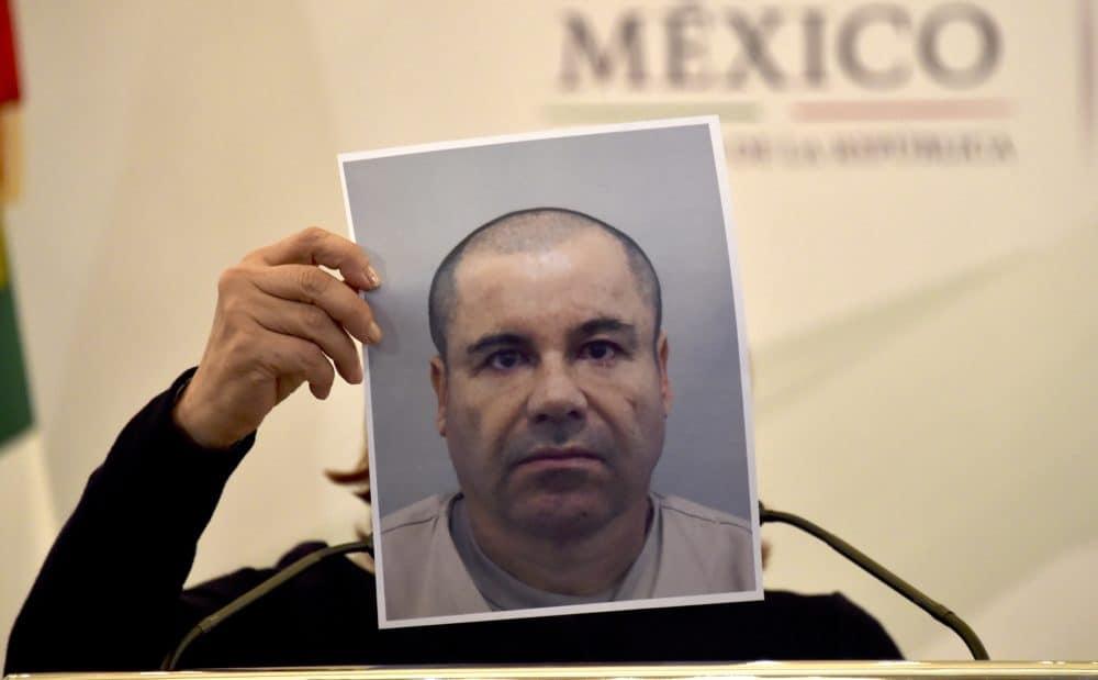 """Mexico's Attorney General Arely Gomez shows a picture of Mexican drug kingpin Joaquín """"El Chapo"""" Guzmán during a press conference held at the Secretaría de Gobernación in Mexico City, on July 13, 2015."""