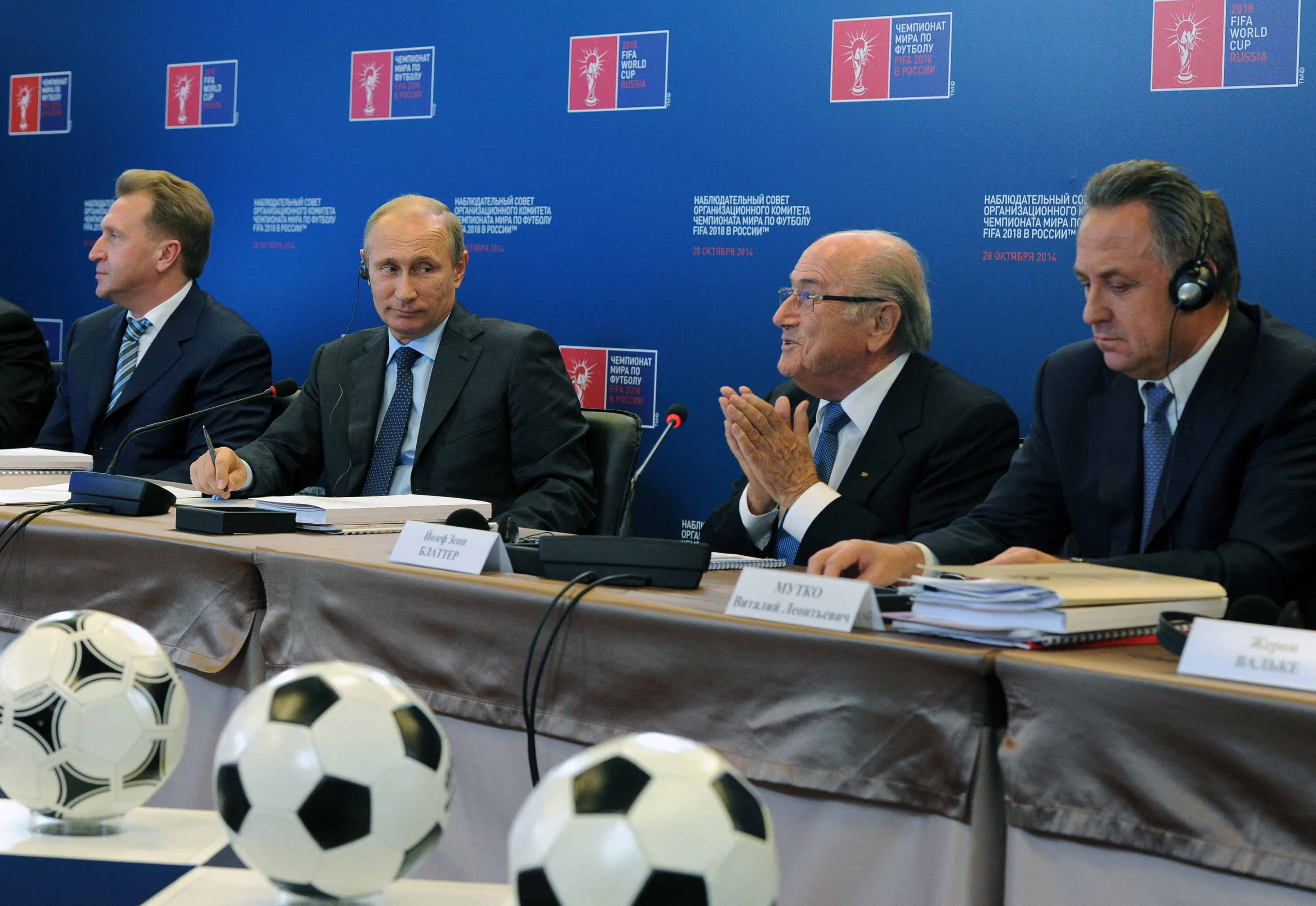 "Outgoing FIFA President Sepp Blatter (2nd R) speaks on Oct. 28, 2014 as Russian President Vladimir Putin (2nd L), First Vice Premier Igor Shuvalov (L) and Sports Minister Vitaly Mutko attend a council ""Russia 2018"" in Moscow."