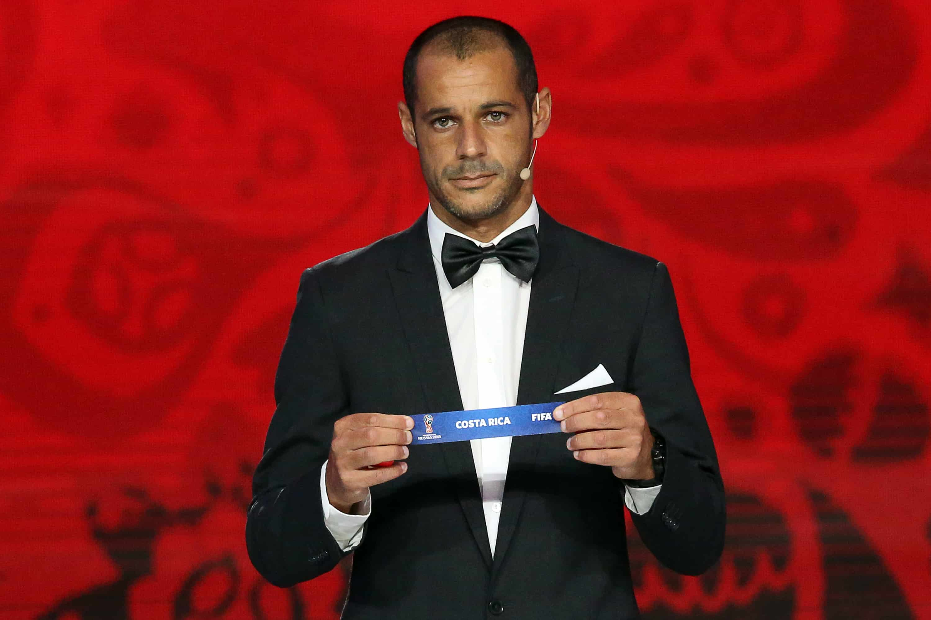 Portugal's beach soccer team forward and captain Madjer shows the name of Costa Rica during the preliminary draw for the Confederation of North, Central American and Caribbean Association Football.