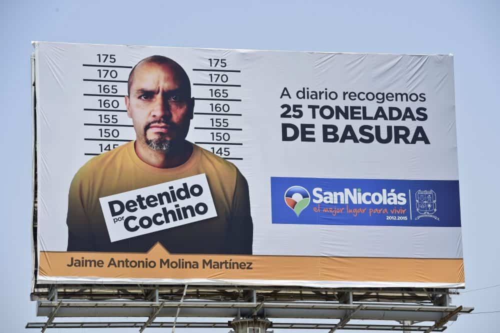 A billboard shows the mugshot of a man arrested for littering in Monterrey.