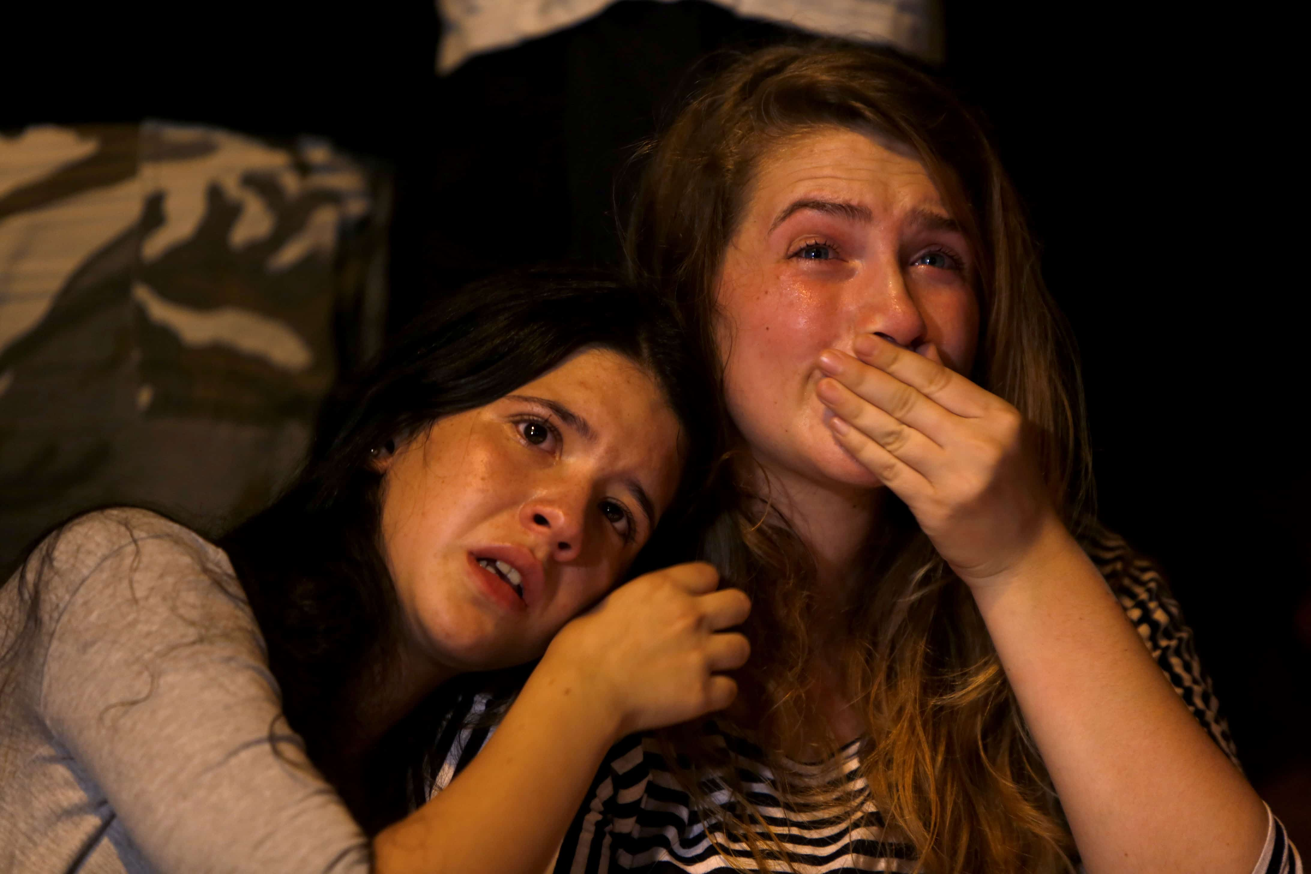 Israeli girls cry during a gathering of hundreds of friends, classmates, teachers, members of the gay community and supporters in downtown Jerusalem.