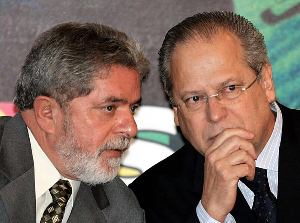 A file photo shows Brazil's ex-President Luiz Inácio Lula da Silva, left, speaking with his then-aide José Dirceu .