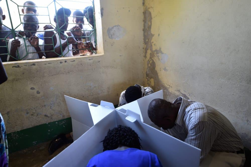 Haitians cast their ballots at a polling station during the Legislative Elections in Port-au-Prince on August 9, 2015.