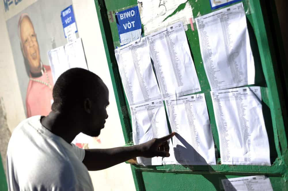 A voter checks a list at a polling station during the legislative elections in Port-au-Prince.