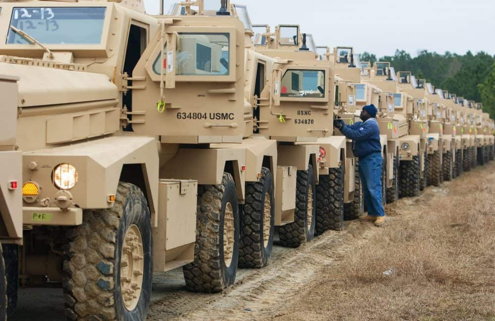 One of a crew of drivers start up hundreds of brand new Mine Resistant Ambush Protected (MRAP) vehicles.