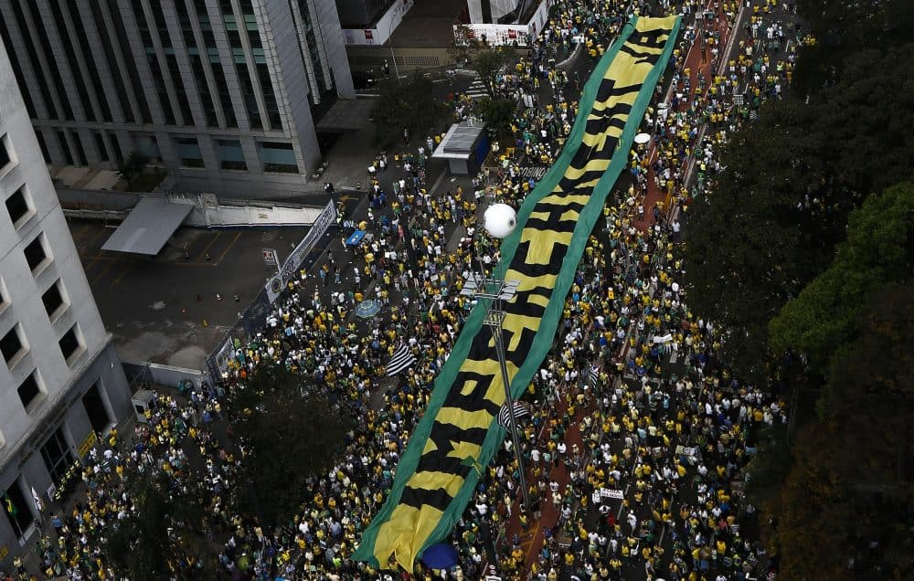 Demonstrators protest against Brazilian President Dilma Rousseff and the ruling Workers Party (PT), at Paulista Avenue in Sao Paulo, Brazil on August 16, 2015.