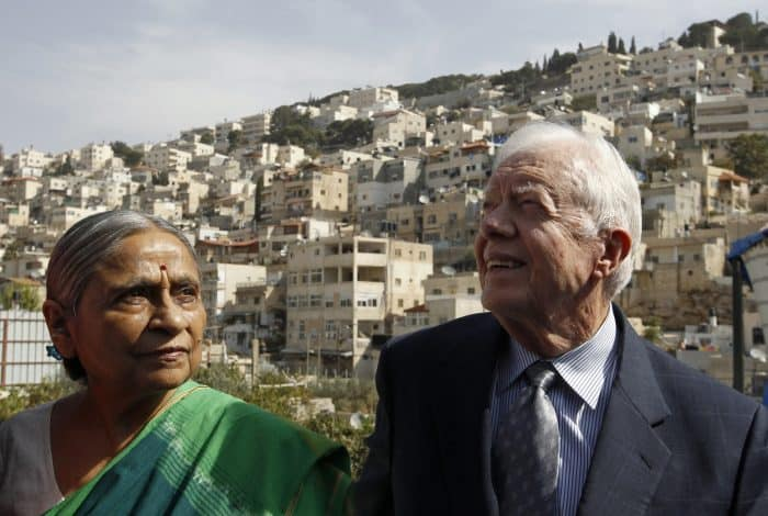 Delegates of The Elders group of retired prominent world figures: Indian activist Ela Bhatt, left, and former U.S. President Jimmy Carter.