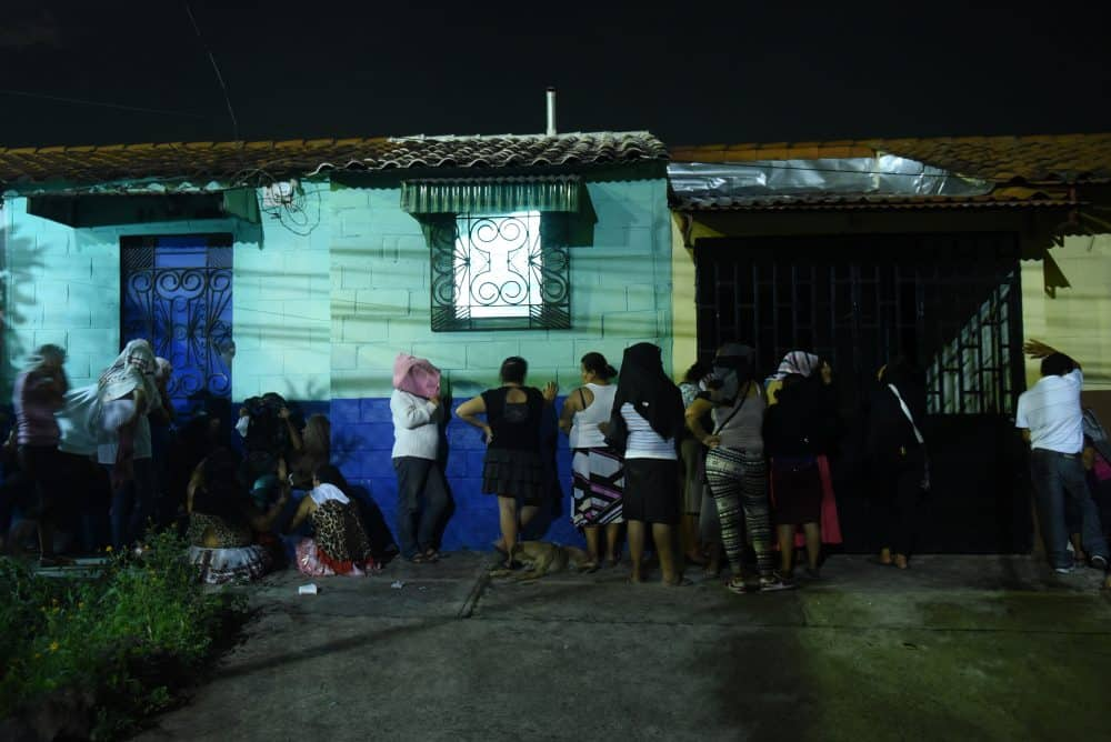 Relatives of inmates await news outside the Quezaltepeque prison in El Salvador, where at least 14 inmates were killed in gang violence.