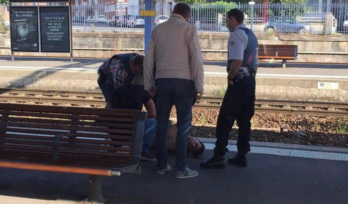 A photo taken by a passenger with a smartphone through the window of a Thalys train shows police detaining a suspect.